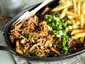 Sous vide cooked pulled pork with French fries