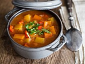 Vegetarian goulash soup with potatoes, carrots and red pepper