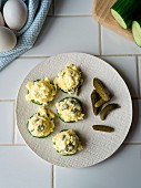 Egg salad with cornichons on cucumber