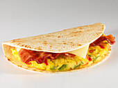 An omelette, bacon and cheese taco