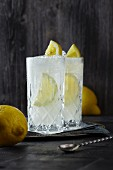Two glasses of Gin Fizz with lemon