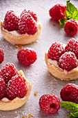Raspberry tarts with sugar