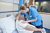 Respiratory physiotherapist and patient