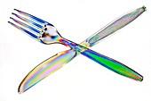 Plastic cutlery under polarised light
