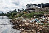 Rubbish and pollution on a river bank