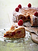 Rhubarb and hazelnut cake with raspberries, sliced