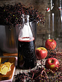 Apple and elderberry juice in a glass bottle