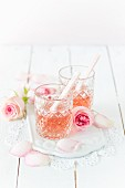 Glasses of rosé champagne with roses
