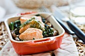 Salmon with horseradish sauce, leafy greens and mushrooms