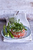 Salmon tartare with wild herbs and green asparagus