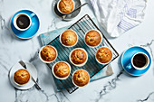 Mandarin muffins with coffee