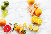 Assorted citrus fruits on a marble background