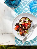 Aubergine with tomato, goat's cheese and olives