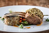A spiced rack of lamb with spinach puree and potatoes