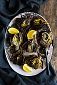 Oven-roasted artichokes with lemon slices