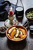 Patatas bravas with broad beans and thyme (Spain)