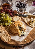 Brie en croute served with grapes and crackers