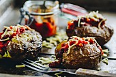 Baked potatoes with chili and grated cheddar