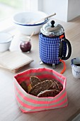 Hand-made fabric bread basket and coffee pot cosy