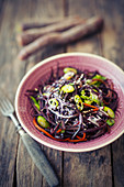 Purple carrot noodles with sesame seeds