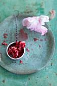Wild rose petals in a sieve