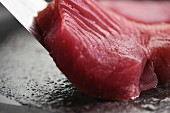 Tuna being fried (close-up)