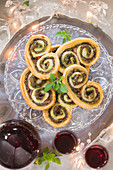 Palmiers with smoked ham, basil and parmesan