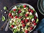 Couscous salad with spinach and raspberries