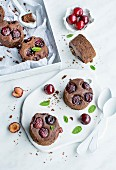 Chocolate brownies with cherries and mint