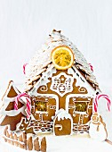 A gingerbread house with candy canes