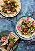 Wraps with broad bean and sesame falafel, yoghurt dressing, beetroot, peas, mint and parsley
