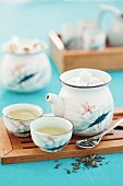 Green tea in Asian-style teacups and a teapot (Asia)