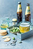 Green olives, crackers and beer