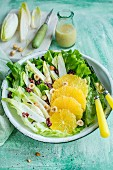 Endive lettuce, orange, nuts and cranberries