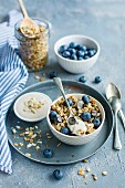 Granola with blueberries and peanut yoghurt