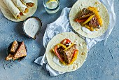 Tempeh fajitas with tomato and red and yellow pepper
