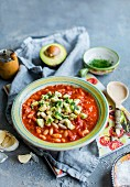White bean and tomato stew with avocado and parsley pesto