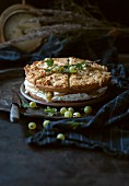 Vegan gooseberry and cream cake with almond and quinoa topping