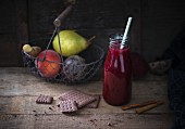 A beetroot smoothie with pear, peach, cinnamon and ginger