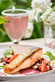 Roast salmon with pomegranate and strawberry dressing and strawberry and cucumber relish