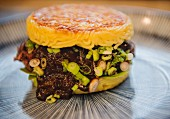 A ramen burger with spring onions (Japan)