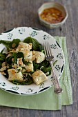 Gnocchi with stinging nettle and flaked almonds