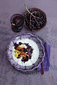 Rice pudding with elderberry sauce and mango