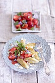 Finger-shaped potato dumplings with strawberry and woodruff salad