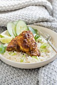 Turmeric chicken on a bed of rice with spring onion