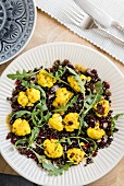 Turmeric and cauliflower salad with lentils, pomegranate seeds and rocket