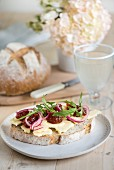 Multigrain bread topped with cheese, chutney, onion and rocket