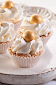 Tartlets with cream and decorative edible gold ball