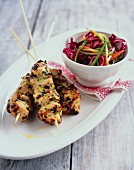 Chicken skewers with vegetable salad