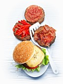 Burger variations with cheese, red pepper, salami and bacon